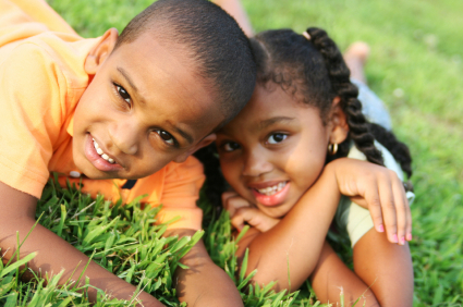 Kids in grass - Pediatric Dentist in Forney, Heath and Kaufman, TX